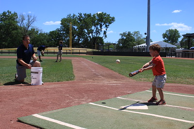 A future superstar connects for a hit during batting practice.