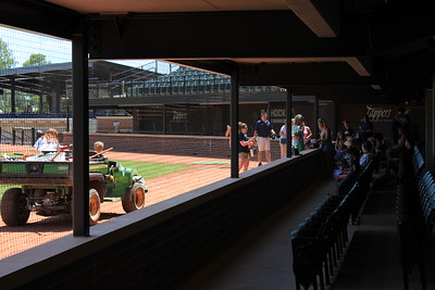 Digital First Media staff and family members cool off in the shade of the premium dugout suite.