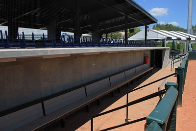 The third-base side dugout. The Cabana Suites are located behind each dugout. In back far right is the Summer Picnic Area.