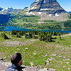 Hiker viewing Hidden Lake at a viewpoint along the Hidden Lake Nature Trail