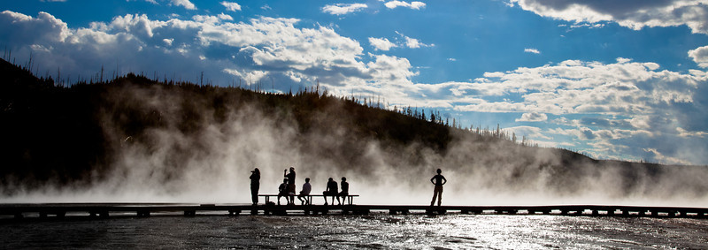 People overlooking the Grand Prismatic Spring