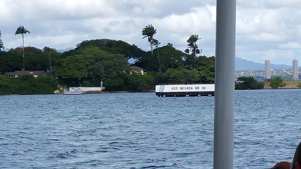 These White floating Barges are where the original ships were moored when the Japanese attacked