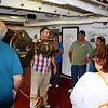 Tour guide talks about the USS Olympia