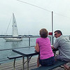 A couple outside the restaurant enjoying the Mystic River view