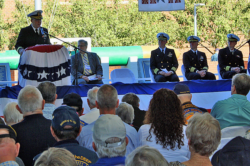 Rear Admiral Michael P. Holland spoke at the Memorial Ceremony.