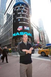 Billy Demong poses in front of the Nasdaq sign in Times Square. October 29, 2009 Photo © 2008, The NASDAQ OMX Group, Inc.