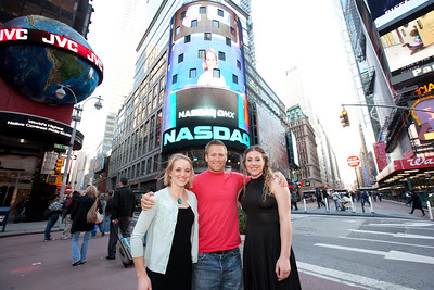 """Liz Stephen, Jerett """"Speedy"""" Peterson and Stacey Cook Athletes pose in front of the Nasdaq sign in Times Square. October 29, 2009 Photo © 2008, The NASDAQ OMX Group, Inc."""
