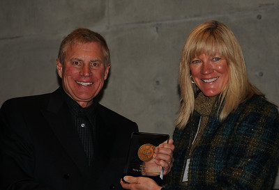Hank Tauber of the FIS accepts the Ullr Award from Connie Nelson on behalf of author Karin Rase at the awards banquet of the International Ski History Association (ISHA) at the Alf Engen Ski Museum at the Utah Olympic Park in Park City, Utah. (USSA/Tom Kelly)