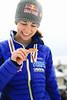 Sarah Hendrickson and her coach, Paolo Bernardi walk through Paolo's hometown of Predazzo,  where Sarah Hendrickson won her World Championship ski jumping gold medal.<br /> <br /> 2013 Nordic World Championships in Val di Fiemme, Italy<br /> Photo: Sarah Brunson/U.S. Ski Team