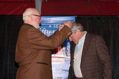 Tom Kelly puts the honorary medal around Joe Jay Jalbert 2014 U.S. Ski Hall of Fame induction in Park City, UT Photo: U.S. Ski Team