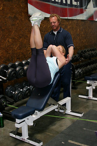 Team trainer Per Lundstam assists a snowboarding athlete at the current Park City training facility. Photo: Scott Sine