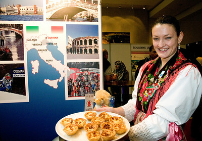 A hostess samples special delicacies at FIS Congress 2008 in Cape Town. (c) 2008 USSA