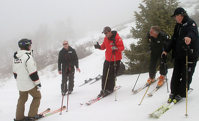 U.S. Ski Team Alpine Director Jesse Hunt (red) gives an on-hill ornentation to participants in the Team's Ski  for Gold High Performance ski clinic at Deer Valley Resort, featuring introduction of exclusive vLink technology. (Photo: Tom Kelly)