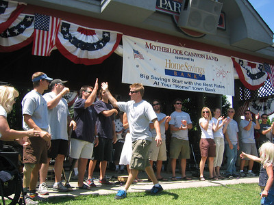 High-fives by Park City's Ted Ligety to all 2006 Olympian and Paralympic athletes at the July 4th festivities.