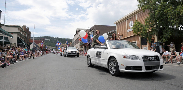 U.S. Ski Team and U.S. Snowboarding athletes take part in the Park City, Utah July Fourth parade.