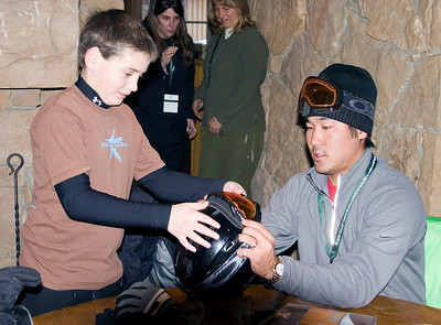Olympic medalist Toby Dawson skis with 11-year old Ryan Long as a part of a Make-a-Wish day for Ryan at Deer Valley Resort in Park City, Utah.