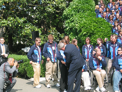 Jackson Hole's Resi Stiegler has the President to sign her 2006 Roots Team jacket (May 17, 2006)