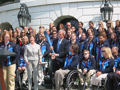 Four-time Paralympic medalists Chris Devlin-Young (Campton, NH) presents the President with a 2006 Olympic torch May 17, 2006)