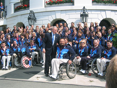 President Bush with Alaska's Joe Tompkins and other 2006 Olympic and Paralympic athletes (May 17, 2006)