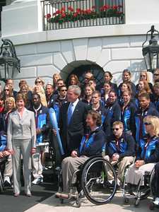 Four-time Paralympic medalists Chris Devlin-Young (Campton, NH) presents the President with a 2006 Olympic torch(May 17, 2006)