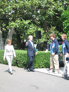 SBX riders Jason Smith (Basalt, CO) and Nate Holland (Squaw Valley, CA) greet President Bush and Mrs. Bush on the South Lawn. (May 17, 2006)