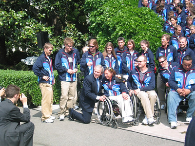 President Bush poses for a photo with four-time Paralympian Candace Cable (May 17, 2006)