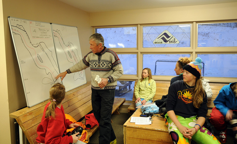 Club Director Aldo Radamus gives a briefing before a morning training session with Ski and Snowboard Club Vail at Golden Peak. Photo: Tom Kelly/USSA