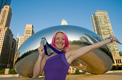 Olympic silver medalist Shannon Bahrke poses in front of Chicago's famous silver bean in Millenium Park during the U.S. Olympic Committee's Media Summit. Bahrke, the 2002 silver medalist in women's moguls, also owns a coffee company - Silver Bean Coffee.