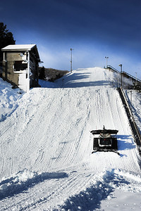 A snowcat works the landing hill at the freestyle aerials jump as the Utah Olympic Park preps for an early opening to pre-season training for the U.S. Ski Team. (c) 2011 USSA/Tom Kelly