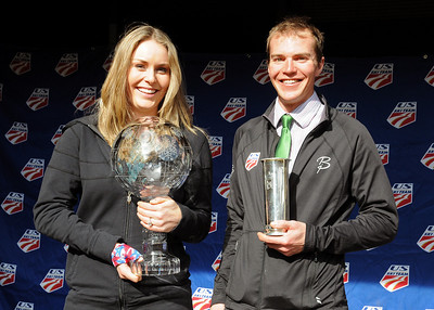 Lindsey Vonn displays her World Cup and Billy Demong his King's Cup as USSA staff congratulate the athletes on their World Championship seasons at a staff gathering at USSA headquarters in Park City,Utah.