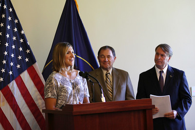 (l-r) Jen Hudak, Utah Governor Gary R. Herbert, President and CEO of the Utah Sports Commission, Jeff Robbins An announcement is made at the Utah State Capitol that the Olympic governing body will bring some of its most important World Cup and Sprint U.S. Grand Prix events to Utah.  Photo: USSA