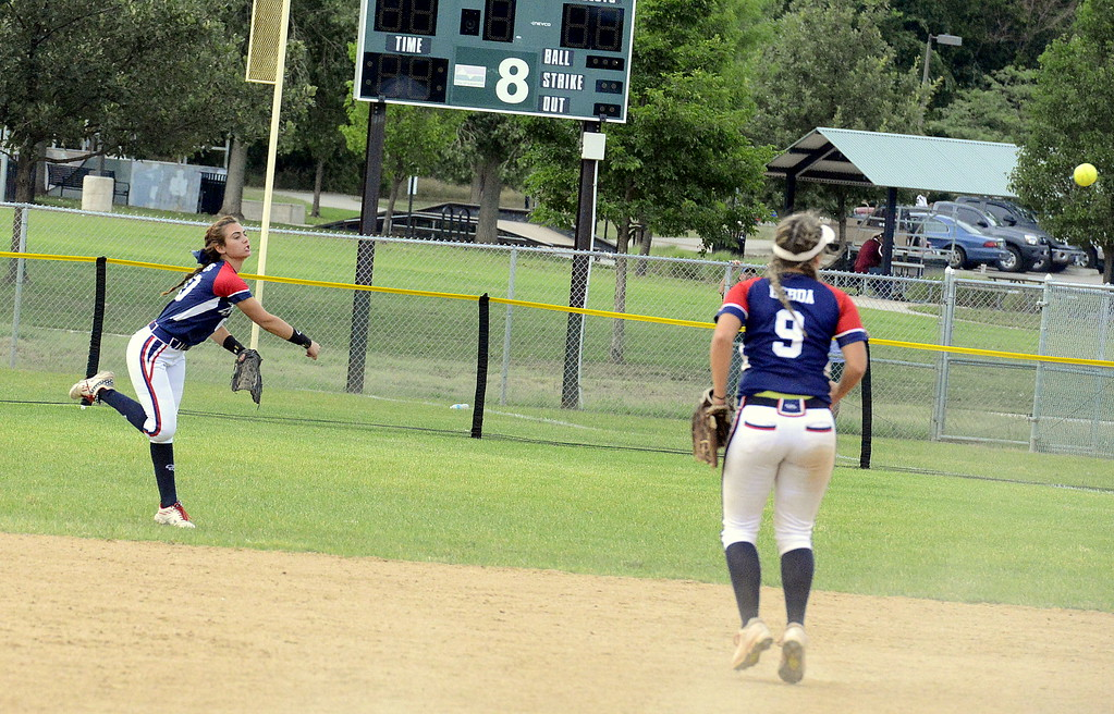 . Right fielder Sotera Dageenakis of Blaze Pride Elite throws to first trying to double off an Altitude runner after making a catch Saturday at the USSSA Mountain States Championships at the Barnes complex. (Mike Brohard/Loveland Reporter-Herald)