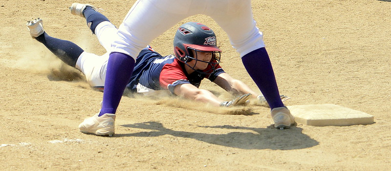 Blaze Pride Elite's Tristan Pope slides safely into third on a hit by teammate Dailey Deal during Saturday's win over the Evolution at the USSSA Mountain States Championships at the Barnes complex. (Mike Brohard/Loveland Reporter-Herald)