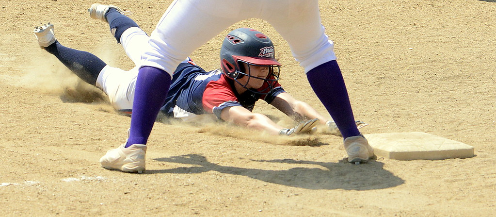 . Blaze Pride Elite\'s Tristan Pope slides safely into third on a hit by teammate Dailey Deal during Saturday\'s win over the Evolution at the USSSA Mountain States Championships at the Barnes complex. (Mike Brohard/Loveland Reporter-Herald)