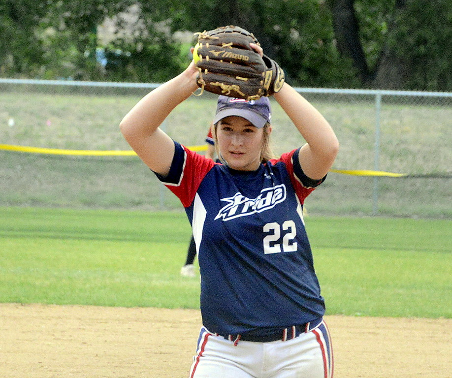 . Blaze Pride Elite pitcher Becca Gruner peers in on her target as she begins her windup during Saturday\'s game against Altitude on Saturday at the USSSA Mountain States Championships at the Barnes complex. (Mike Brohard/Loveland Reporter-Herald)