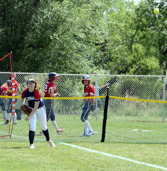 Blaze Pride Elite left fielder Tristan Pope throws the ball to shortstop Hailey Johnson, who threw home to cut down an Evolution runner at the plate at the USSSA Mountain States Championships at the Barnes complex. (Mike Brohard/Loveland Reporter-Herald)