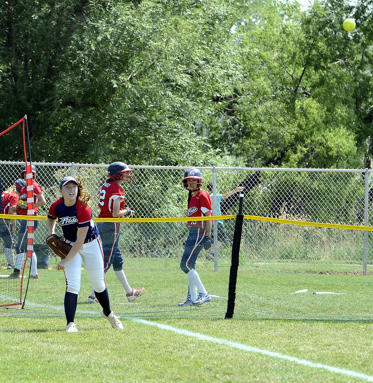 . Blaze Pride Elite left fielder Tristan Pope throws the ball to shortstop Hailey Johnson, who threw home to cut down an Evolution runner at the plate at the USSSA Mountain States Championships at the Barnes complex. (Mike Brohard/Loveland Reporter-Herald)