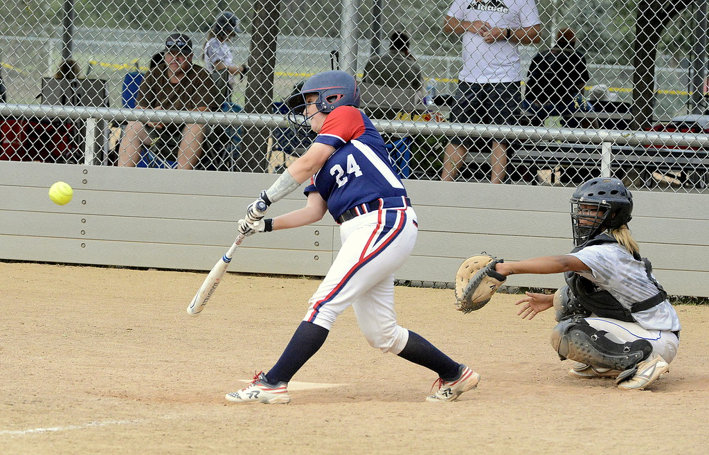 . Shaeli Herman of Blaze Pride Elite slices a hit to right field Saturday against Altitude at the USSSA Mountain States Championships at the Barnes complex. (Mike Brohard/Loveland Reporter-Herald)