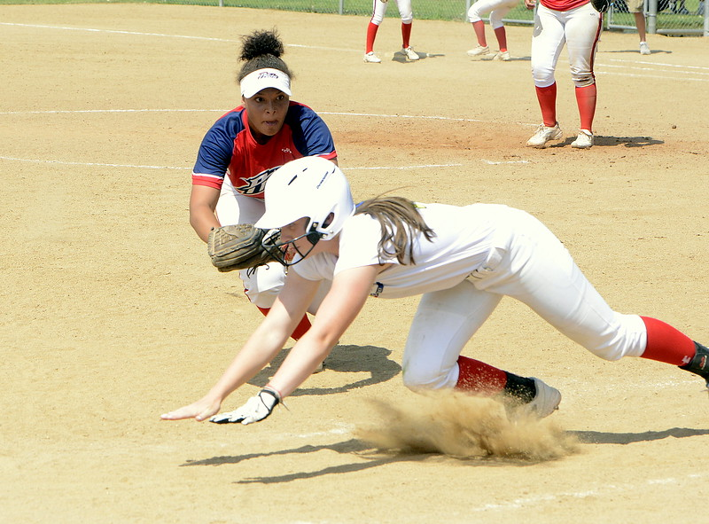 RaLeigh Basart dives back to third before Pride-Watts shortstop Hannah Jensen can apply the tag in their game Saturday at the USSSA Mountain States Championships at the Barnes complex. (Mike Brohard/Loveland Reporter-Herald)