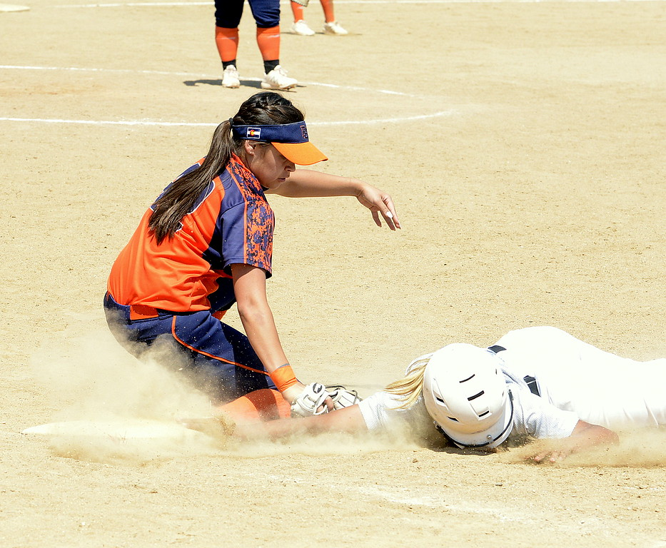 . Colorado Atltitude base runner Bailey Spinuzzi beats the tag of Pro Swing Orange first baseman Lexie Elkins during their game Saturday at the USSSA Mountain States Championships at the Barnes complex. (Mike Brohard/Loveland Reporter-Herald)