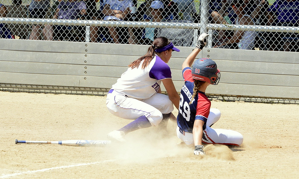 . Blaze Pride Elite shortstop Hailey Johnson beats the throw home to score on a wild pitch in Saturday\'s game with Evolution at the USSSA Mountain States Championships at the Barnes complex. (Mike Brohard/Loveland Reporter-Herald)