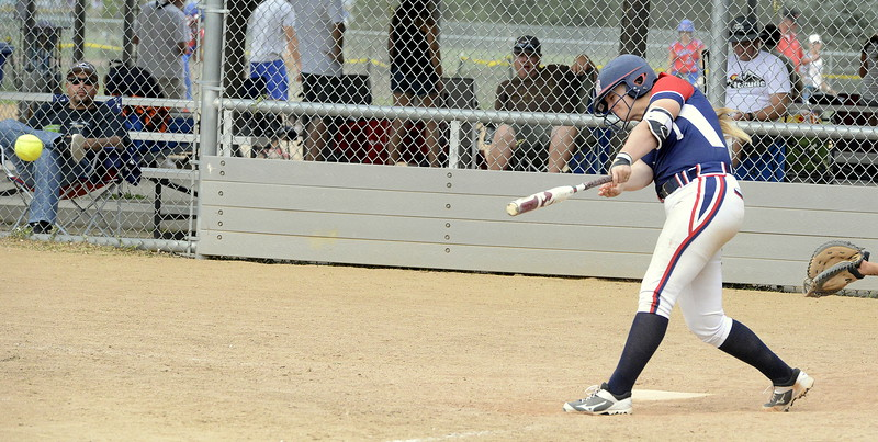 Blaze Pride Elite's Makaila Chadwick follows through on her swing as she laces a ball for a hit against Altitude on Saturday at the USSSA Mountain States Championships at the Barnes complex. (Mike Brohard/Loveland Reporter-Herald)