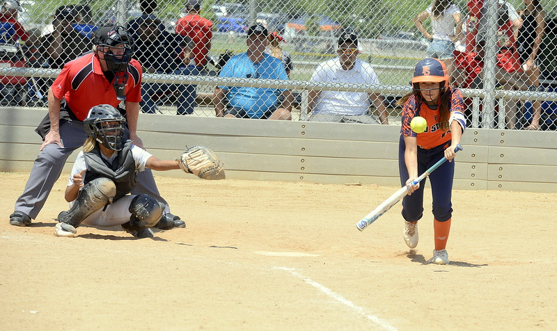 Pro Swing Orange leadoff hitter Rei Miramontes puts down a bunt to open Saturday's game with Colorado Altitude at the USSSA Mountain States Championships at the Barnes complex. (Mike Brohard/Loveland Reporter-Herald)