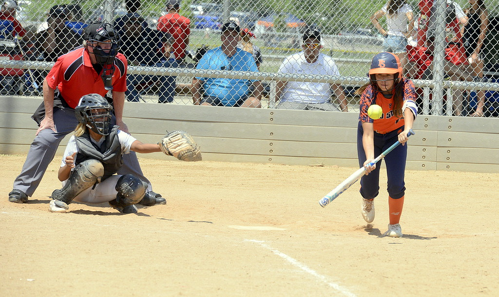 . Pro Swing Orange leadoff hitter Rei Miramontes puts down a bunt to open Saturday\'s game with Colorado Altitude at the USSSA Mountain States Championships at the Barnes complex. (Mike Brohard/Loveland Reporter-Herald)