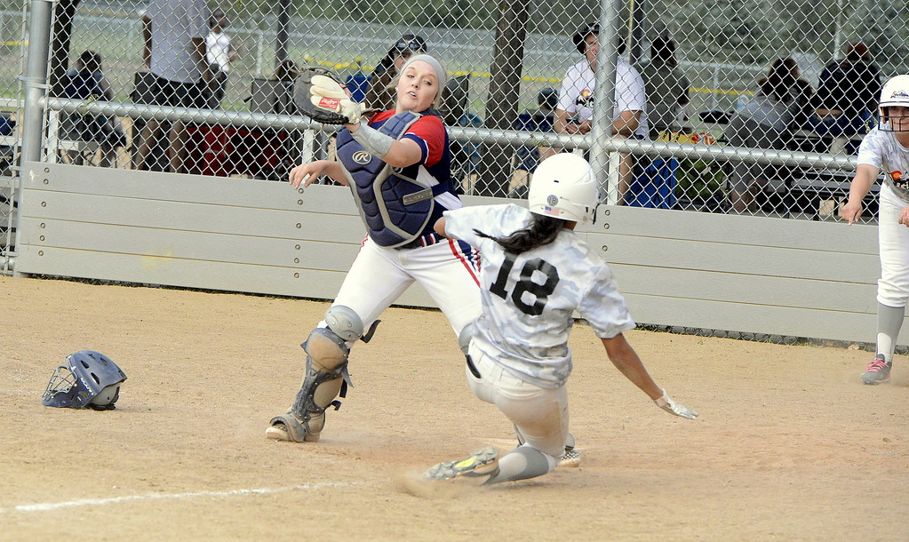 . Blaze Pride Elite catcher Shaeli Herman takes a throw from the outfield too late to tag out Altitude\'s Delaney Barela during Saturday\'s game at the USSSA Mountain States Championships at the Barnes complex. (Mike Brohard/Loveland Reporter-Herald)