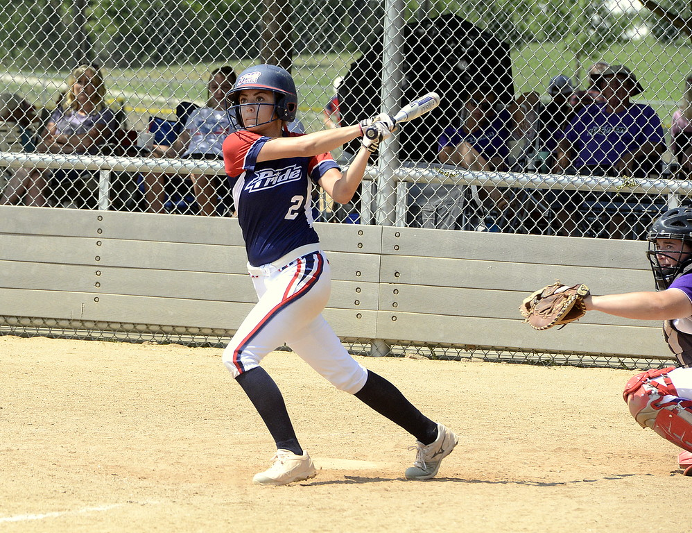 . Blaze Pride Elite\'s Bailey Deal watches her hit to left field during Saturday\'s win over the Evolution at the USSSA Mountain States Championships at the Barnes complex. (Mike Brohard/Loveland Reporter-Herald)