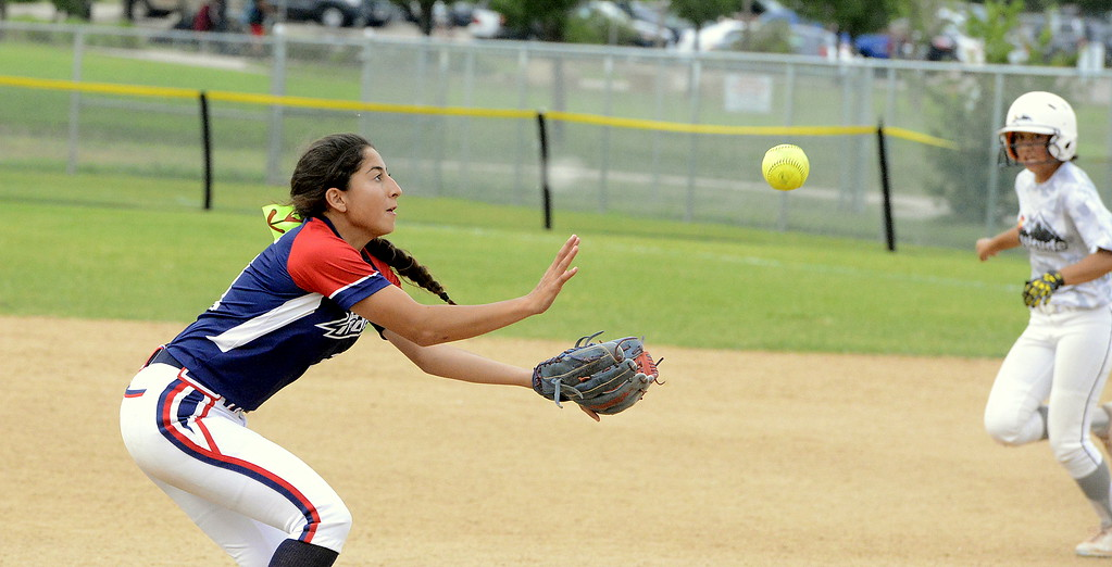 . Blaze Pride Elite shortstop Savannah Vasquez moves into snare a soft liner in Saturday\'s game against Altitude at the USSSA Mountain States Championships at the Barnes complex. (Mike Brohard/Loveland Reporter-Herald)
