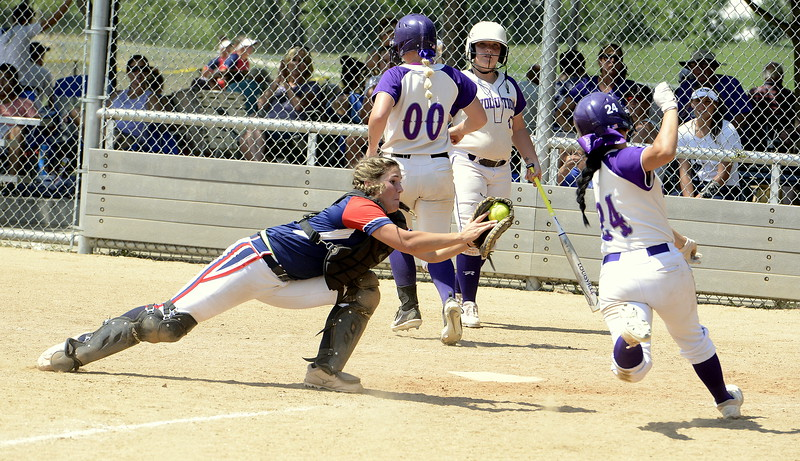 Blaze Pride Elite catcher Marlee Hebda starts her dive to tag out Evolution's Mia Fernandes at the plate Saturday at the USSSA Mountain States Championships at the Barnes complex. (Mike Brohard/Loveland Reporter-Herald)