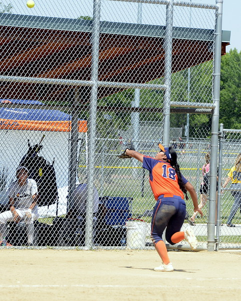 Pro Swing Orange third baseman Joslyn Running Wolf goes for a foul ball during Saturday's game with Colorado Altitude at the USSSA Mountain States Championships at the Barnes complex. (Mike Brohard/Loveland Reporter-Herald)