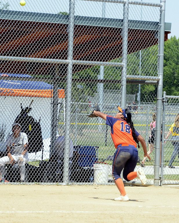 . Pro Swing Orange third baseman Joslyn Running Wolf goes for a foul ball during Saturday\'s game with Colorado Altitude at the USSSA Mountain States Championships at the Barnes complex. (Mike Brohard/Loveland Reporter-Herald)
